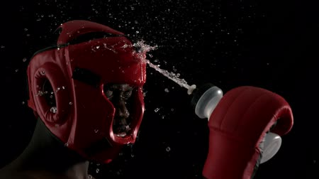 pour out : Tough boxer pouring water over himself in slow motion Stock Footage
