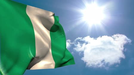 nigeria flag : Nigeria national flag waving on blue sky background with sun and clouds