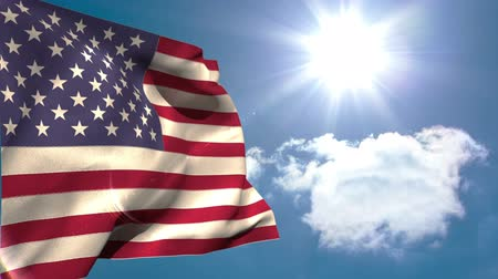 blue flag : American national flag waving on blue sky background with sun and clouds Stock Footage