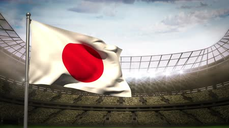 japan : Japan flag waving on flagpole in football stadium with flashes