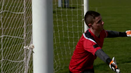 trest : Goalkeeper in red letting in a goal during a game in slow motion Dostupné videozáznamy