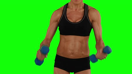 část těla : Super fit woman lifting dumbbells in black sports bra and shorts on green screen background Dostupné videozáznamy