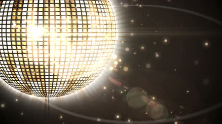 disko : Digital animation of Shiny gold disco ball spinning around