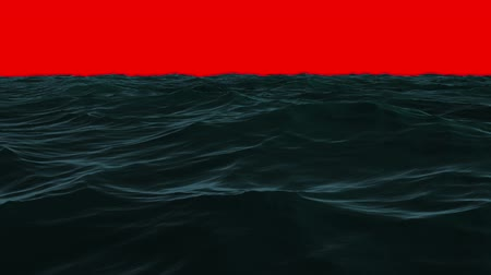 mar vermelho : Digital animation of Choppy blue ocean under red screen sky