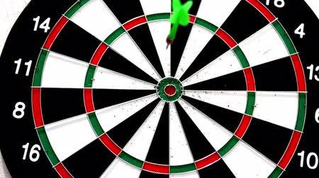 dart : Green dart hitting the bullseye on white background in slow motion Stock Footage