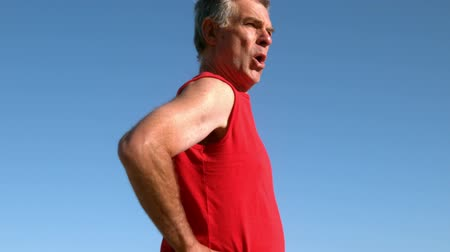 jogging : Senior man jogging on sunny day in slow motion