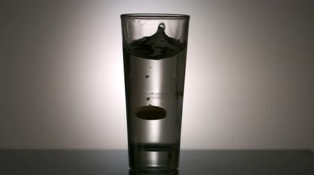 vitamin : Effervescent vitamin tablet in glass of water in slow motion