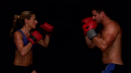 boxe : Strong couple punching towards each other in slow motion