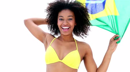 brazília : Pretty girl in yellow bikini cheering on white background