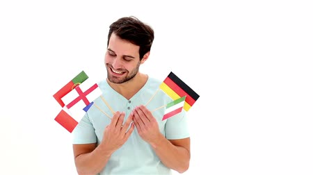 portugese : Handsome young man showing flags on white background