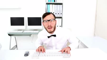 nerd : Nerd typing and getting stressed at desk in his office