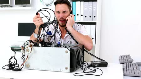 technikus : Angry technician pulling wires in broken computer in his office