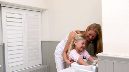 banyo : Cute little girl washing hands with her mother at home in bathroom