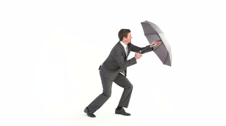 vento : Businessman opening umbrella and struggling on white background