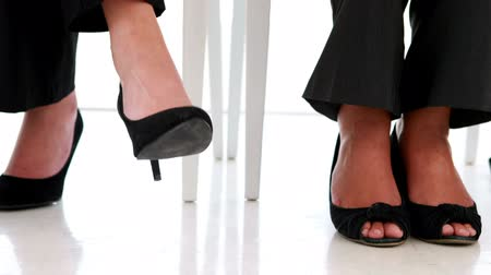 gergin : Businesswoman shaking her feet nervously in the office