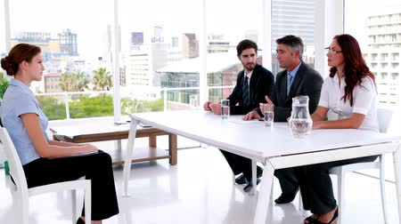 сотрудники : Interview panel speaking with young applicant in the office