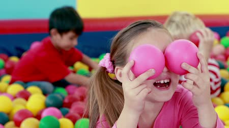 ostoba : Cute children playing and having fun in the ball pool in playschool