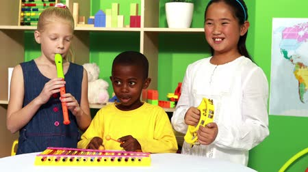 instrumentos : Cute little class making music together in playschool