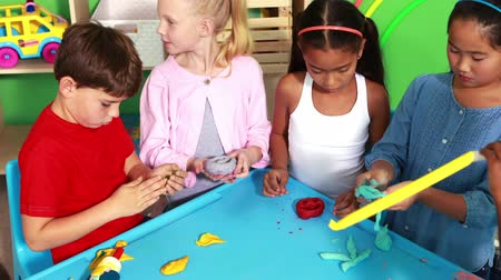 zanaat : Cute classmates playing with clay in playschool Stok Video