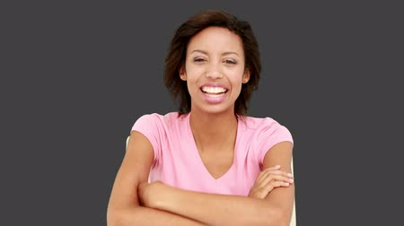 speaking : Pretty smiling woman talking to the camera on grey screen background Stock Footage