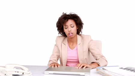 apprehensive : Businesswoman feeling stressed at her desk on white background