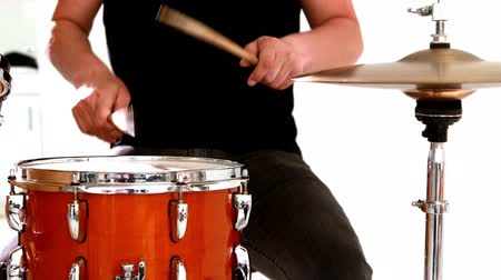 davulcu : Drummer playing his drum kit on white background Stok Video