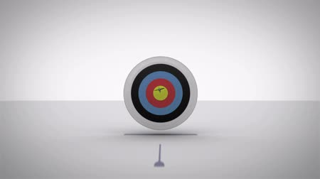nyíl : Arrow flying towards dart board and hitting target on green screen background Stock mozgókép