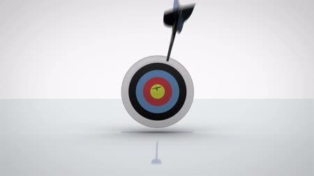 цель : Arrows flying towards dart board and hitting target on grey background Стоковые видеозаписи