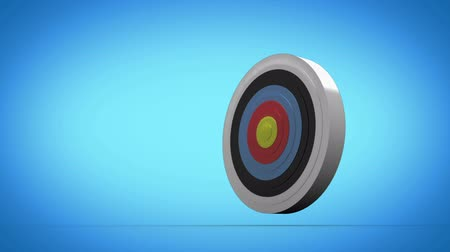 цель : Arrow flying towards dart board and hitting target on grey background