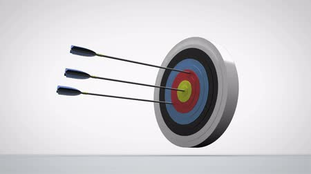 цель : Arrows flying towards dart board and hitting target on white background Стоковые видеозаписи
