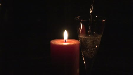 hot wine : Pouring Champagne by Candle light