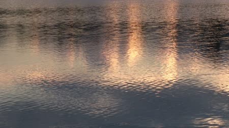 göl : The ripples of the water in a lake at the evening time.