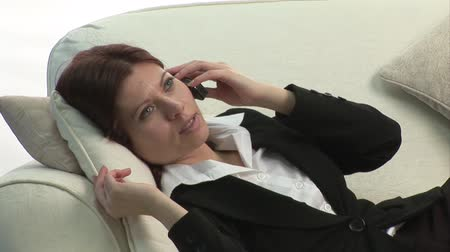 profi : Stock Video Footage of a Businesswoman on Sofa Stock mozgókép
