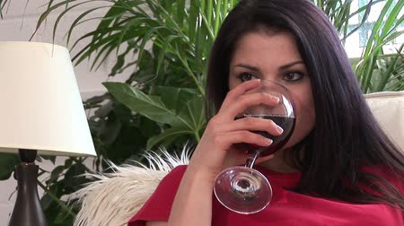 lefekvés : Lifestyle Stock Video Footage of a Woman Drinking Red Wine on Sofa