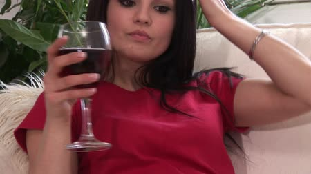 estilo de vida : Lifestyle Stock Video Footage of a Woman Drinking Red Wine on Sofa
