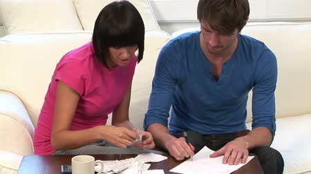 utilidade : Stock Video Footage of a Young Couple Working out domestic finances