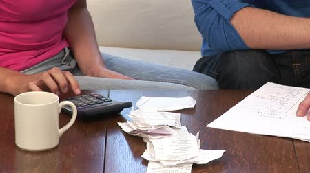 harc : Stock Video Footage of a Young Couple Working out domestic finances