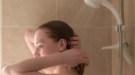 banyo : Stock Video Footage of a woman Relaxing in the shower