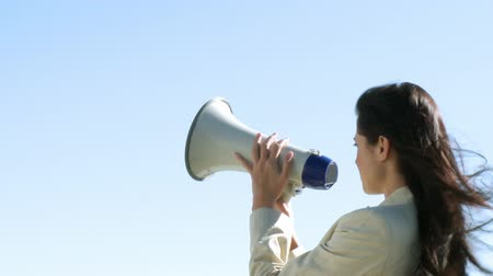 мегафон : Smart Businesswoman giving instruction via megaphone