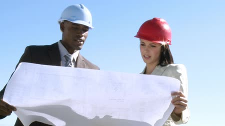 blueprint : Two architects professional talking about the implementation of a plan Stock Footage