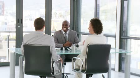 corporate affairs : Three sucessful managers at a desk talking about marketing