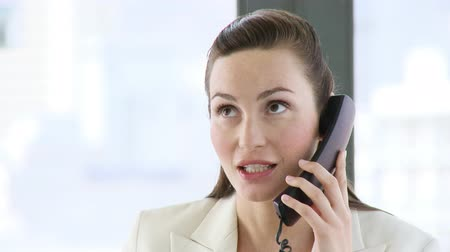 on the phone : Businesswoman talking on her cellular phone