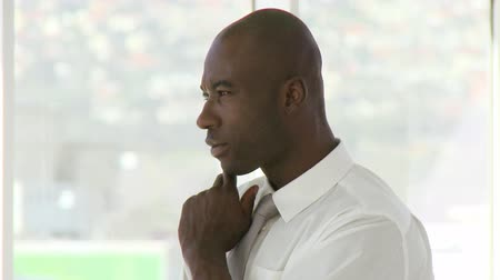 corporate affairs : AfroAmerican business manager listening to a presenation