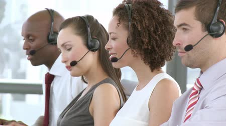 executivo : Obliging Business team talking on headsets