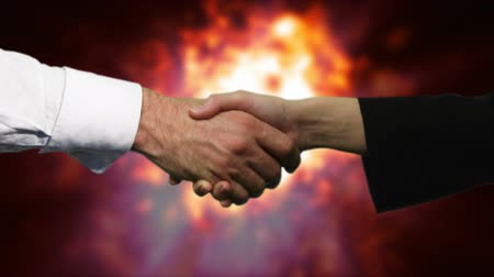 обещание : HD business Handshake with Explosion in the background