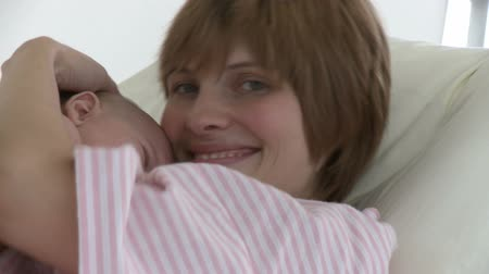 choise : Happy young mother with her baby in a hospital Stock Footage