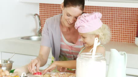 paylaşımı : Happy Mother and daughter baking together