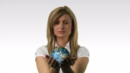 womans hand : Rotating 3D Globe in a womans hand 2 Stock Footage