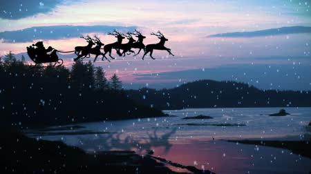 santa : HD Animation of Santa Claus and reindeer flying over landscapes. Christmas
