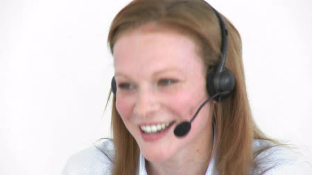 hívó : Footage in high definition of young businesswoman with a headset on working in a call center